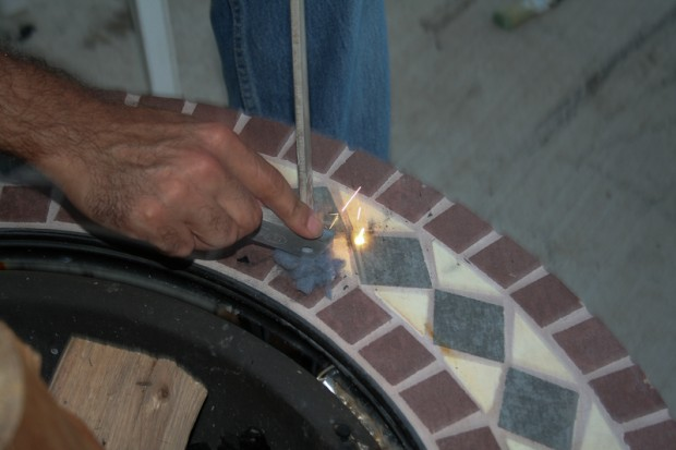 Here I'm using a flint to throw sparks onto the dryer lint